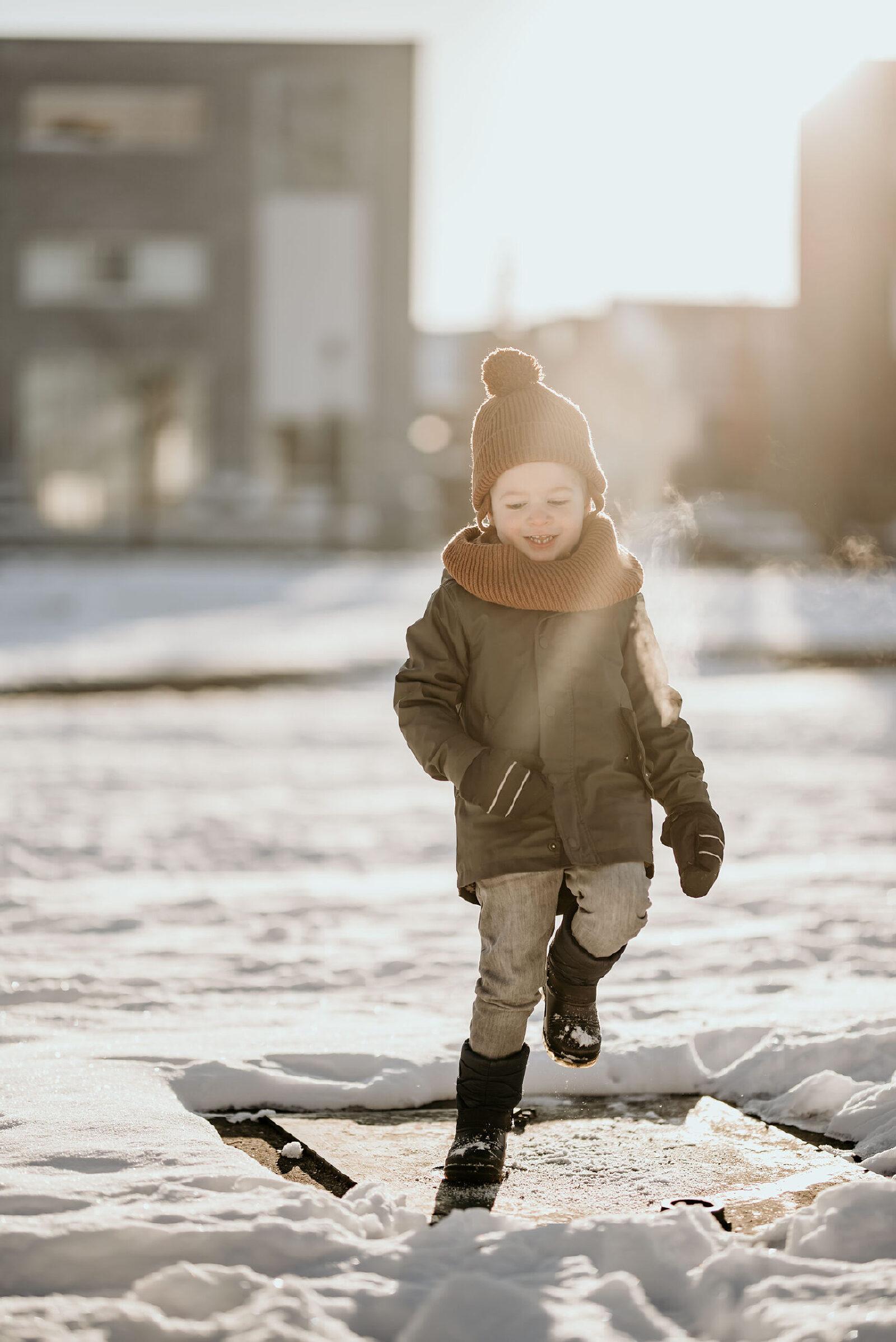 sneeuw zon kinderfotografie Enschede Hengelo